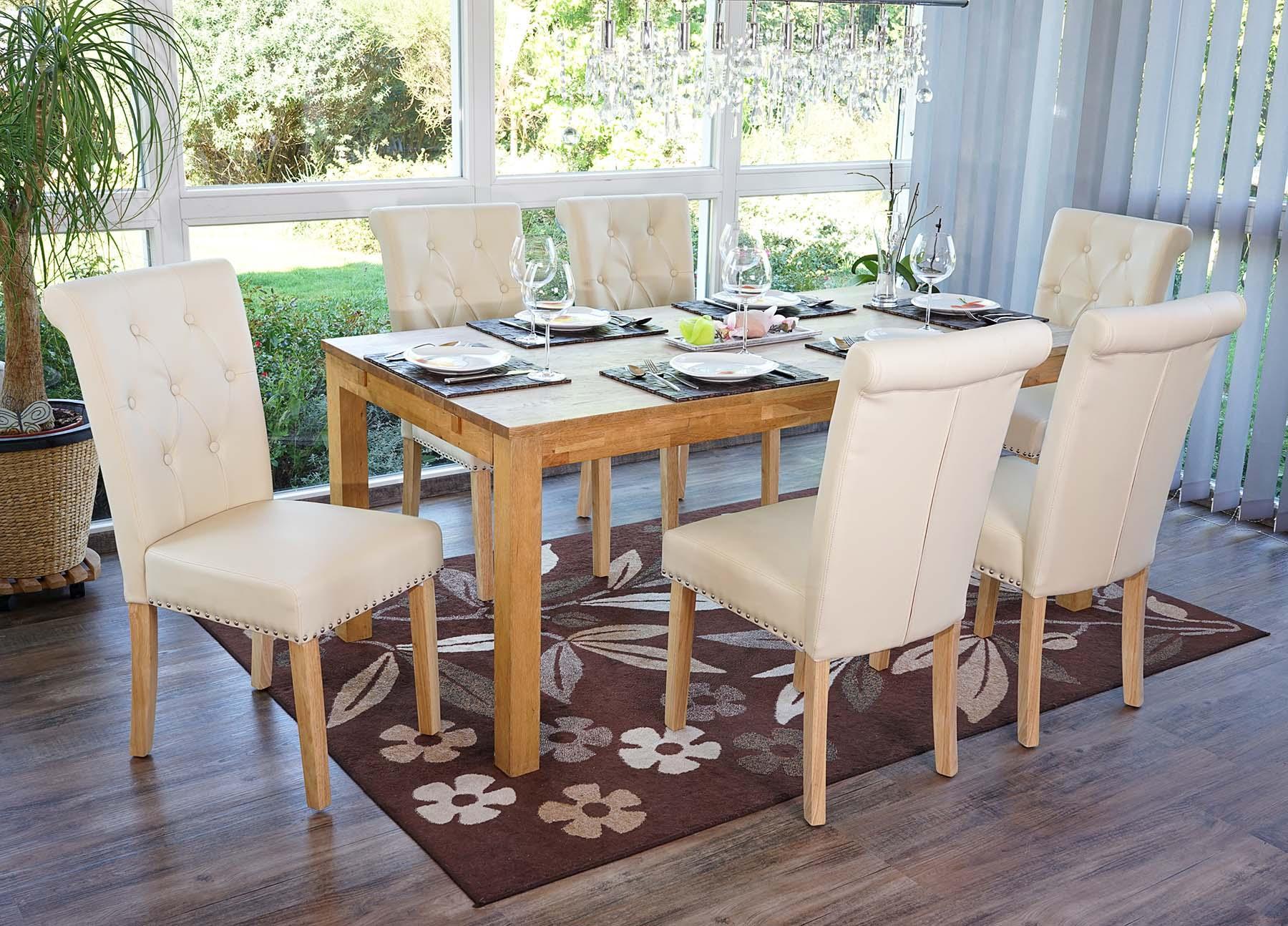 Conjunto de 4 sillas de comedor odesa piel crema y patas for Sillas capitone comedor